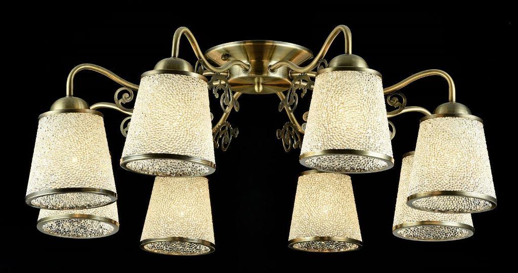 Люстра MaytoniЛюстры<br>Назначение светильника: для гостиной, Стиль светильника: классика, Тип: потолочная, Материал светильника: металл, стекло, Материал плафона: стекло, Материал арматуры: металл, Длина (мм): 740, Ширина: 740, Высота: 260, Количество ламп: 8, Тип лампы: накаливания, Мощность: 40, Патрон: Е27, Цвет арматуры: бронза, Родина бренда: Германия, Коллекция: toc017<br>